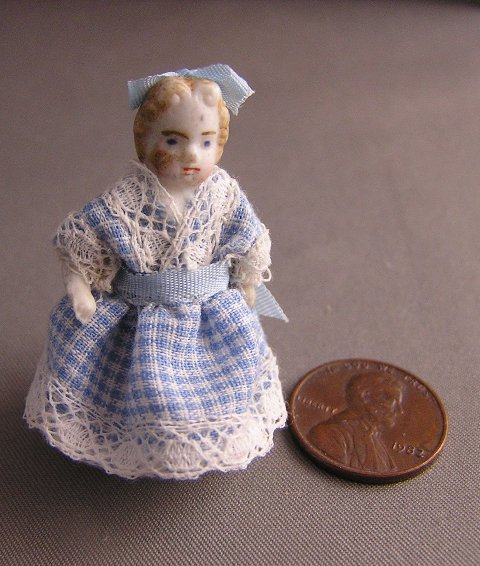 Bisque Penny Doll in Blue Dress - Click Image to Close