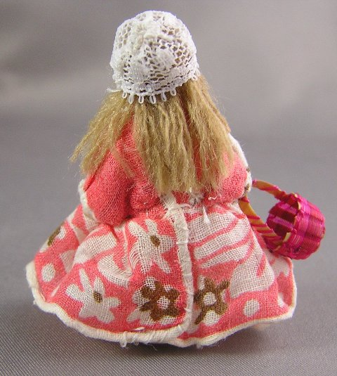 """Frozen"" Bisque Doll with a Basket"